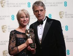 Dame Helen Mirren winner of outstanding contribution and Jeremy Irons poses for photographers in the winners room at the EE British Academy Film Awards held at the Royal Opera House on Sunday Feb. 16, 2014, in London. (Photo by Joel Ryan/Invision/AP)