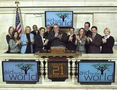 FILE - In this Jan. 21, 2009 photo provided by the New York Stock Exchange, Rev. Carl Keyes, founder of Aid for the World, rings the opening bell at the New York Stock Exchange. On Wednesday, May 14, 2014, Keyes and his wife, Donna, two New York City ministers who were the subject of an Associated Press expose, have agreed to pay $1.2 million to resolve allegations that they used congregation funds to enrich themselves and buy a luxury home. (AP Photo/NYSE)