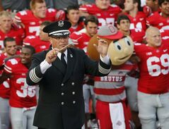 In this Sept. 7, 2013 photo, Ohio State University marching band director Jon Waters leads the band in