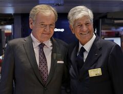 FILE - This July 29, 2013, file photo shows Omnicom Group President and CEO John Wren, left, and Publicis Groupe Chairman and CEO Maurice Levy pose for photos on the floor of the New York Stock Exchange in New York City. The CEO of Publicis Groupe, Maurice Levy, says the planned deal with Omnicom to create the world's largest advertising firm collapsed over unresolvable differences over how to implement a