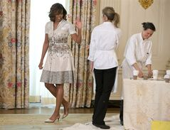 ADVANCE FOR MONDAY, JUNE 2 AND THEREAFTER -This photo taken May 12, 2014 shows first lady Michelle Obama waving as she leaves the crafts area as she and Jill Biden hosted their annual Mother's Day tea to honor military mothers at White House in Washington. Sure, living in the White House has its perks. But a clothing allowance is not one of them. First ladies feel all sorts of pressure to project a fashionable look, and over the decades they've tried a range of cash-saving strategies to pull it off without going broke. Seven frugal do's _ and don'ts _ that first ladies have tried over the years: Even first ladies recycle their clothes. Michelle Obama recently welcomed military moms to a Mother's Day Tea wearing the same shirtdress she'd worn to lunch with Katy Perry in 2012. (AP Photo)