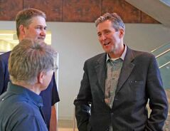 Progressive Conservative Leader Brian Pallister, right, meets with Steve Dzubinski and Russ Paddock of the Healthy Living Centre during a brief visit to Brandon University on Friday as part of a weekend tour of western Manitoba.
