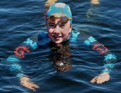 Cali Bruce, 14, of Truro, N.S., trains for the Big Swim crossing of the Northumberland Strait, a 14-kilometre event where 49 swimmers cross the Strait between New Brunswick and Prince Edward Island, near the Confederation Bridge, in this undated handout photo. THE CANADIAN PRESS/HO - Colin Bruce