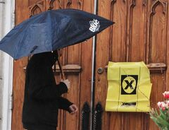 A voter enters a polling station for the federal election, May 2 , 2011 in Ottawa. THE CANADIAN PRESS/Fred Chartrand
