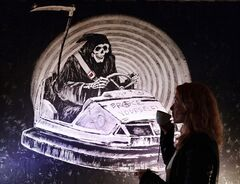 A restored wall graffiti artwork by famed street artist Banksy, is put on display to the public, Thursday April 24, 2014, in London. The artworks are taken from street walls, restored and presented for sale, valued at up to 1 million pounds (US $1.68 million). Seven pieces of Banksy graffiti art are being sold at auction on Sunday April 27, although the elusive artist released a statement on Banksy's website Thursday saying the