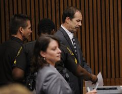 Theodore Wafer is led out of the courtroom by Wayne County Sheriff, Wednesday, Sept. 3, 2014, 2014, in Detroit, after he was sentenced to at least 17 years in prison for killing an unarmed woman on his porch. During the trial, he said he shot 19-year-old Renisha McBride because he feared for his life, but a jury rejected Wafer's claim of self-defense. (AP Photo/Detroit News, Clarence Tabb Jr.) DETROIT FREE PRESS OUT; HUFFINGTON POST OUT, MANDATORY CREDIT