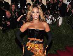 FILE - This May 6, 2013 file photo shows singer Beyonce at The Metropolitan Museum of Art's Costume Institute benefit in New York. Beyonce has released her new album in an unconventional way: She announced and dropped it on the same day. The singer released