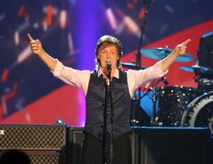 "FILE - In this Jan. 27, 2014 file photo, Paul McCartney performs at The Night that Changed America: A Grammy Salute to the Beatles, in Los Angeles. McCartney has been treated for a virus that led him to cancel his tour in Japan. Publicist Perri Cohen says in a statement Thursday, May 22, that McCartney ""has received successful medical treatment at a hospital in Tokyo."" Cohen adds that the icon is expected to make a complete recovery and will be taking time to rest. McCartney cancelled his entire"