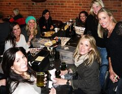 "This undated photo provided by Upstairs Circus shows women attending a recent night of crafting wine bottle tumblers and beaded wrap bracelets at the bar in Denver. People craft with others for lots of reasons, including for fellowship, to learn new skills and to energize their lives. Upstairs Circus is a relatively new downtown Denver bar that caters to crafters. ""It's something constructive to do besides just to eat and drink,"" says co-owner Matt Johannsen. (AP Photo/Upstairs Circus, Matt Johannsen)"