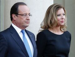 "FILE - In this Sept. 3, 2013 file photo, French president Francois Hollande and his companion Valerie Trierweiler wait for German President Joachim Gauckand, at the Elysee Palace, in Paris. France's former first lady says she and the president had grown detached recently but she was caught totally by surprise by his affair with an actress. Trierweiler told the weekly Paris-Match, where she long worked as a journalist, that she didn't believe rumors about the affair until a gossip magazine report earlier this month. ""When I found out, it was like I had fallen from a skyscraper,"" she is quoted as saying. (AP Photo/Jacques Brinon, File)"