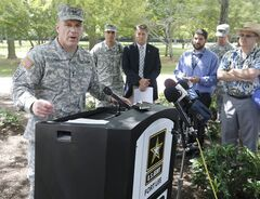 Army Major General Stephen Lyons speaks during a news conference at the base in Fort Lee, Va., Monday, Aug. 25, 2014. A female soldier with a gun inside a key building at a Virginia Army base turned the weapon on herself, causing an injury, but didn't wound any others as the heavily trafficked base temporarily went on lockdown Monday morning. (AP Photo/Steve Helber)