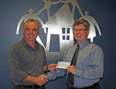 Brent Muirhead (right) presents a $10,000 cheque on behalf of the RBC Foundation to CFS Western CEO Dave McGregor.