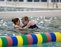 A volunteer helps a swimmer do laps at Seven Oaks pool in Winnipeg during a Making Waves swim program lesson. The non-profit, volunteer-based program, which offers swimming lessons to children with disabilities, is hoping to garner the support of the Brandon community to offer the program locally.