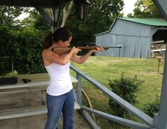 Kentucky democratic Senatorial candidate Alison Lundergan Grimes shoots a rifle at her home, in a Twitter photo posted on Nov. 8, 2013. THE CANADIAN PRESS/HO, Twitter @AlisonForKY