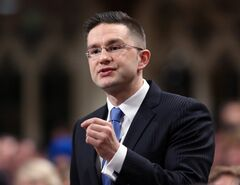 Pierre Poilievre, Minister of State for Democratic Reform stands in the House of Commons during Question Period, in Ottawa Tuesday, February 4, 2014. THE CANADIAN PRESS/Fred Chartrand
