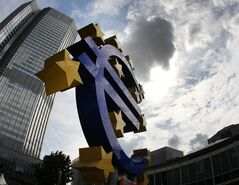 FILE - In this July 31, 2012 file photo the euro sculpture stands in front of the headquarters of the European Central Bank, ECB, in Frankfurt, Germany. Europe's economy failed to gain any momentum in the first quarter, solidifying expectations that the European Central Bank will soon back fresh stimulus measures to shore up the recovery. (AP Photo/Michael Probst, File)