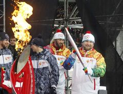 Chechen leader Ramzan Kadyrov, right, takes part in a welcome ceremony of the Olympic torch relay in Chechnya's provincial capital Grozny, southern Russian, Tuesday, Jan. 28, 2014. THE CANADIAN PRESS/AP, Musa Sadulayev