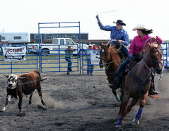 Tanner and Amarra Cook participate in the team roping competition at the Sprucewoods Heartland Rodeo on Saturday.