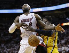 Indiana Pacers center Roy Hibbert (55) blocks a shot to the basket by Miami Heat's LeBron James (6) during the second half Game 6 in the NBA basketball playoffs Eastern Conference finals on Friday, May 30, 2014, in Miami. (AP Photo/Lynne Sladky)