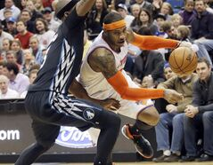 FILE - In this March 5, 2014, file photo, New York Knicks' Carmelo Anthony, right, leaves the floor as he drives around Minnesota Timberwolves' Dante Cunningham in the second half of an NBA basketball game in Minneapolis. A person with knowledge of the details says Carmelo Anthony is staying with the New York Knicks. THE CANADIAN PRESS/AP, Jim Mone