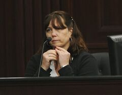 Rhonda Rouer, fiance of Michael Dunn testifies, Tuesday, Feb. 11, 2014 in Jacksonville, Fla. Michael Dunn, the Florida man charged with fatally shooting a 17-year-old boy after an argument over loud music testified Tuesday that he thought he saw the barrel of a gun from a neighboring vehicle pointed at him and that he feared for his life before firing his weapon. (AP Photo/The Florida Times-Union, Bob Mack, Pool)