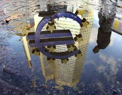 FILE - In this Thursday, Jan. 5, 2012 file photo, a person is reflected in a puddle alongside the Euro sculpture in front of the European Central Bank in Frankfurt, Germany. International investors are recovering their appetite for euros as the shared currency recovers from a debt crisis that threatened to break it up. (AP Photo/Michael Probst, File)