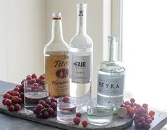 This June 30, 2014 photo shows an assortment of vodkas from left to right, Tito's Handmade, Fair Quinoa and Reyka in Concord, N.H. (AP Photo/Matthew Mead)