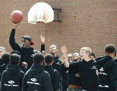 NBA first-overall draft pick Andrew Wiggins, of Canada, left, plays with a bunch of kids while filming a commercial after signing an endorsement deal with BioSteel Sports Drink at his old school in Concord, Ont., on Monday, August 11, 2014. THE CANADIAN PRESS/Nathan Denette