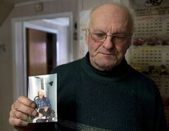 Jean-Andre Michaud holds a photo of his father, Paul-Etienne Michaud, 96, at his home Saturday, January 25, 2014 in L'Isle-Verte, Que. Michaud died in the fire at a seniors residence Thursday, Jan, 22, 2014. THE CANADIAN PRESS/Ryan Remiorz