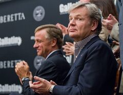 Franco Gussalli Beretta, a director of Beretta USA Corp., right, and Tennessee Gov. Bill Haslam applaud during a ceremony at the state Capitol in Nashville, Tenn., on Wednesday, Jan. 29, 2014, to announce a new firearms plant being built in the state. The $45 million manufacturing and research facility is planned to be completed this year and could create 300 jobs. (AP Photo/Erik Schelzig)