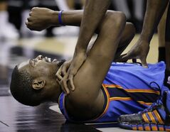 Oklahoma City Thunder's Kevin Durant grimaces after he was fouled by San Antonio Spurs' Tim Duncan during the second half of an NBA basketball game, Wednesday, Jan. 22, 2014, in San Antonio. (AP Photo/Eric Gay)