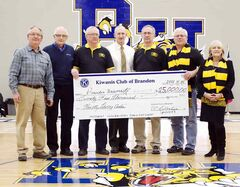 Representatives of the Kiwanis Club attended a Bobcat basketball game on Nov. 30, during which they donated $25,000 to Brandon University's Healthy Living Centre. Pictured  are (L-R): Tom Breneman, fundraising chair for the centre; Kiwanis Club president Vern Gilbertson; member Don Smith; club secretary D'Arcy Barker; member John Rice; club treasurer Frank Thomas; and BU president Deborah Poff.