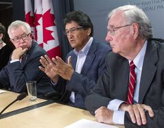 From left, former Prime Ministers Joe Clark and Paul Martin look on as former Assembly of First Nations Chief Ovide Mercredi (centre) responds to questions during a news conference in Ottawa on Thursday, September 4, 2014. THE CANADIAN PRESS/Fred Chartrand
