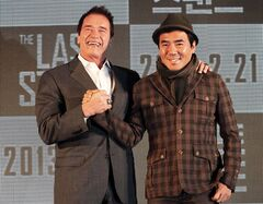 Actor Arnold Schwarzenegger, left, poses with South Korean director Kim Jee-woon before a press conference to promote their latest film