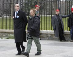FILE - This Feb. 13, 2013 file photo shows Sierra Club Executive Director Michael Brune being arrested outside the White House in Washington, as prominent environmental leaders tied themselves to the White House gate to protest the Keystone XL oil pipeline. President Barack Obama is sticking to a fossil-fuel dependent energy policy, delivering a blow to a monthslong, behind-the-scenes effort by nearly every major environmental group to convince the White House that the policy is at odds with his goals on global warming. (AP Photo/Ann Heisenfelt, File)
