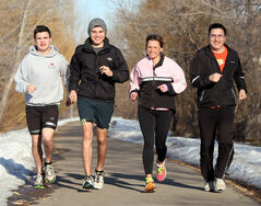 From left, Riley, Dylan, Deanna and James Peyachew hit the walking path in Brandon as they prepare for the upcoming Boston Marathon.