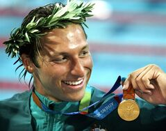FILE - In this Aug. 16, 2004 file photo, Ian Thorpe of Australia, smiles with his gold medal after winning the 200-metre freestyle at the Olympic Aquatic Centre at the 2004 Olympic Games in Athens. Australian media report the five-time Olympic swimming gold medalist will reveal he is gay in a television interview with English talk show host Michael Parkinson, to be broadcast in Australia Sunday.