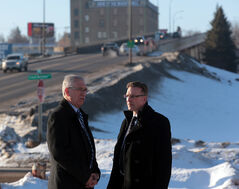 Brandon-Souris Conservative MP Larry Maguire, left, and Peter Braid, parliamentary secretary to the minister of infrastructure and communities, discuss the traffic bottleneck problems with the Daly Overpass at the foot of the 18th Street overpass on Thursday.