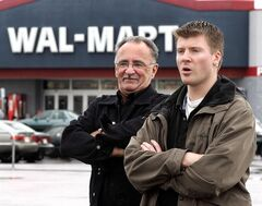 Pierre Martineau, left, and Patrice Bergeron, two of the Wal-Mart workers who initiated the unionization, stand in front of their workplace, a Wal-Mart department store, Sept. 28, 2004 in Jonquiere, Que. The Supreme Court of Canada has found in favour of Quebec workers who were fired from a Wal-Mart in Jonquiere, Que., after it shut its doors suddenly and says the former employees must be compensated. THE CANADIAN PRESS/Jacques Boissinot