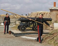 Members of the 78th Highlanders prepare to fire the noon gun on Citadel Hill in Halifax on Monday April 10, 2006. A decades-long dispute between Halifax and the federal government over the value of Citadel Hill will go before a panel Monday to help determine how much Ottawa owes the city in back taxes for the national historic site.THE CANADIAN PRESS/Andrew Vaughan