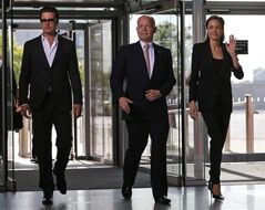 CORRECTS THAT JOLIE AND PITT ARE NOT MARRIED British Foreign Secretary William Hague, centre, US actress Angelina Jolie, right, Special Envoy of the United Nations High Commissioner for Refugees, and US actor and Jolie's partner Brad Pitt, left, arrive at the 'End Sexual Violence in Conflict' summit in London, Thursday, June 12, 2014. The Summit welcomes governments from over 100 countries, over 900 experts, NGOs, Faith leaders, and representatives from international organizations across the world. (AP Photo/Lefteris Pitarakis)
