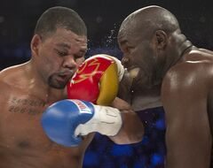 Mike Perez, left, from Cuba, takes a right to the head from Carlos Takam, from Cameroon, during their heavyweight bout on Saturday, January 18, 2014 in Montreal. The bout ended with a majority draw.THE CANADIAN PRESS/Ryan Remiorz