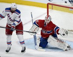 Montreal Canadiens goalie Dustin Tokarski (35) makes a glove save on New York Rangers left wing Rick Nash (61) during third period in game five of the NHL Eastern Conference final Stanley Cup playoff action Tuesday, May 27, 2014 in Montreal.THE CANADIAN PRESS/Ryan Remiorz