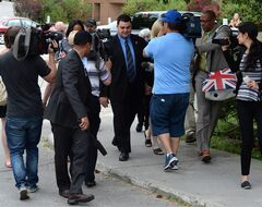 MP Dean Del Mastro is followed by media as he leaves court during a recess in Peterborough, Ont. on Monday June 23, 2014. THE CANADIAN PRESS/Sean Kilpatrick