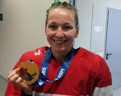 Jocelyne Larocque, Olympic women's defender from Ste. Anne, Man., poses Thursday with her new gold medal.