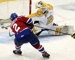 Wheat Kings goalie Jordan Papirny, who was brilliant all night, stretches to try to stop Cody Corbett's shot.