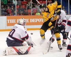Stelio Mattheos of the Brandon Wheat Kings leaps out of the way of a shot on Regina Pats goalie Jordan Hollett during Western Hockey League action at Westman Place on Saturday evening. The Pats won 6-0 to wrap up both teams' regular seasons as they prepare for the playoffs.