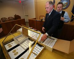 Appraiser Howard Herz talks about gold coins being auctioned off more in Carson City, Nev., on Tuesday, Feb. 26, 2013. Sixty-nine-year-old Walter Samaszko, Jr. died in June 2012, leaving thousands of gold coins in his garage. A portion of his collection brought $3.5 million today at the auction. (AP Photo/Las Vegas Review-Journal, Cathleen Allison)