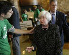 Federal Reserve Chair Janet Yellen, right, speaks with Ady Barkan of the Center for Popular Democracy as she arrives for a dinner during the Jackson Hole Economic Policy Symposium at the Jackson Lake Lodge in Grand Teton National Park near Jackson, Wyo. Thursday, Aug. 21, 2014. (AP Photo/John Locher)