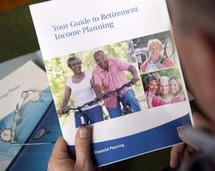 A man looks at a retirement planning brochure January 13, 2014 in Montreal. THE CANADIAN PRESS/Ryan Remiorz